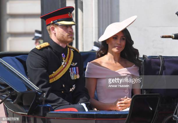 Prince Harry Duke of Sussex and Meghan Duchess of Sussex travel in an open carriage to the Trooping the Colour ceremony on June 09 2018 in London...