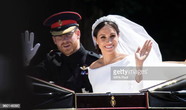 Prince Harry Duke of Sussex and Meghan Duchess of Sussex travel in the Ascot Landau Carriage during their carriage procession after their wedding on...