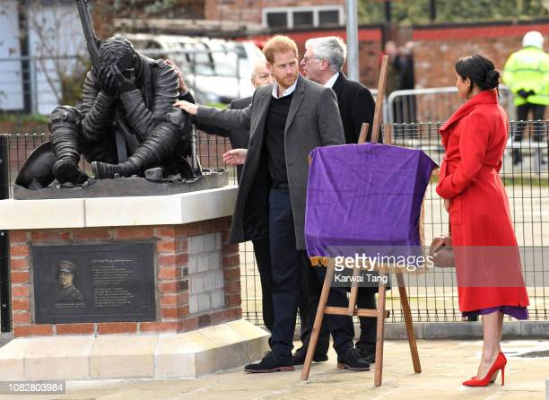 Prince Harry Duke of Sussex and Meghan Duchess of Sussex view a new sculpture erected in November to mark the 100th anniversary of Wilfred OwenÕs...