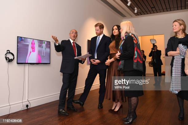 Prince Harry Duke of Sussex and Meghan Duchess of Sussex view a special exhibition of art by Indigenous Canadian artist Skawennati in the Canada...