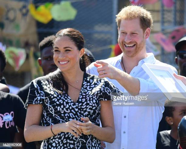 Prince Harry, Duke of Sussex and Meghan, Duchess of Sussex visit a Justice Desk initiative, a workshop that teaches children about their rights,...