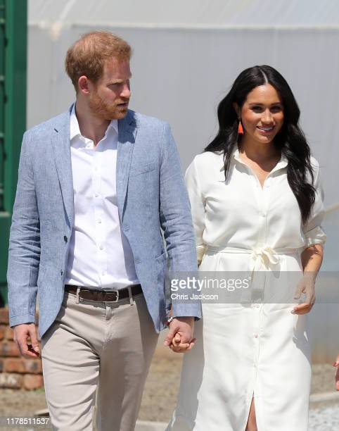 Prince Harry Duke of Sussex and Meghan Duchess of Sussex visit a township to learn about Youth Employment Services on October 02 2019 in Johannesburg...