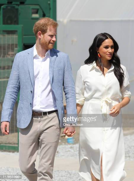 Prince Harry, Duke of Sussex and Meghan, Duchess of Sussex visit a township to learn about Youth Employment Services on October 02, 2019 in...