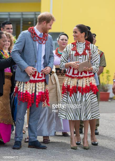 Prince Harry Duke of Sussex and Meghan Duchess of Sussex visit an exhibition of Tongan handicrafts mats and tapa cloths at the Fa'onelua Convention...