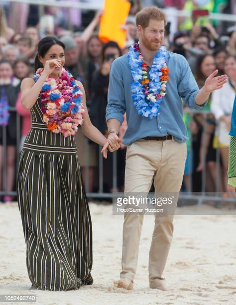 Prince Harry Duke of Sussex and Meghan Duchess of Sussex visit Bondi Beach on October 19 2018 in Sydney Australia The Duke and Duchess of Sussex are...