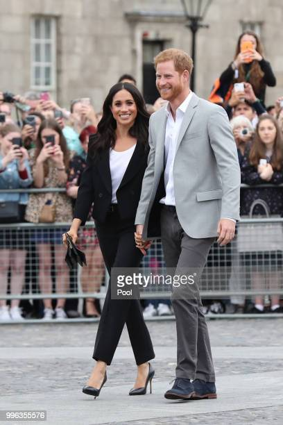 Prince Harry Duke of Sussex and Meghan Duchess of Sussex visit Trinity College on the second day of their official two day royal visit to Ireland on...