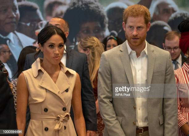 Prince Harry Duke of Sussex and Meghan Duchess of Sussex visit the Nelson Mandela Centenary Exhibition at Southbank Centre's Queen Elizabeth Hall on...