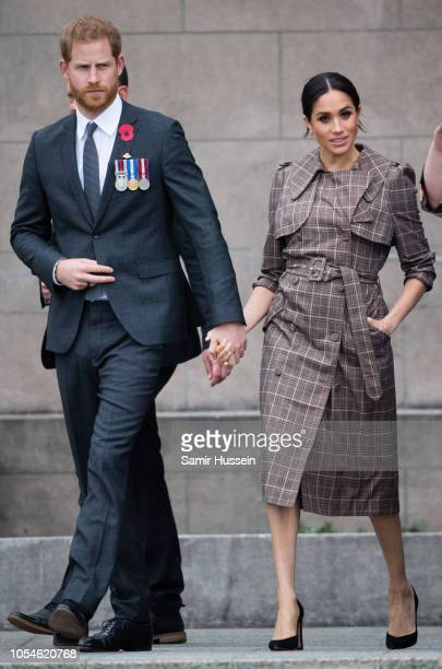 Prince Harry Duke of Sussex and Meghan Duchess of Sussex visit the National War Memorial on October 28 2018 in Wellington New Zealand The Duke and...