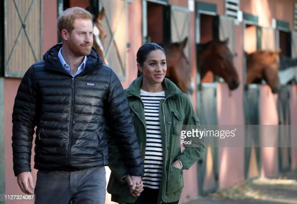 Prince Harry Duke of Sussex and Meghan Duchess of Sussex visit the Moroccan Royal Federation of Equitation Sports on February 25 2019 in Rabat...