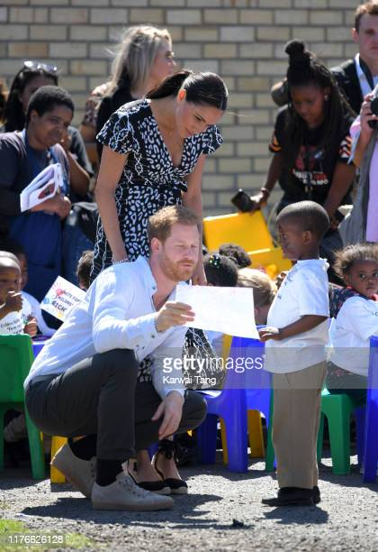 Prince Harry Duke of Sussex and Meghan Duchess of Sussex visit the Nyanga Township during their royal tour of South Africa on September 23 2019 in...