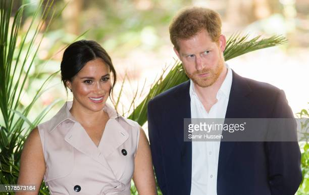 Prince Harry Duke of Sussex and Meghan Duchess of Sussex visit the British High Commissioner's residence to attend an afternoon reception to...