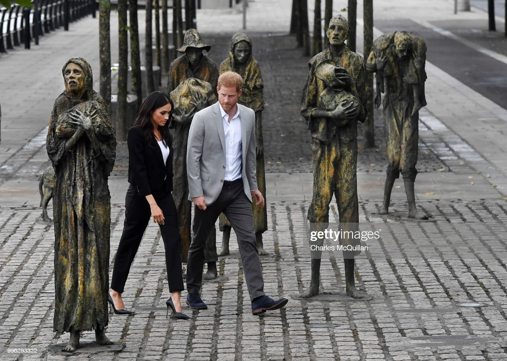 Prince Harry, Duke of Sussex and Meghan, Duchess of Sussex visit the Famine Memorial at Custom House Quay on the second day of their official two day royal visit to Ireland on July 11, 2018 in Dublin, Ireland. The statues commemorate the Great Famine of the mid 19th century, during which a million people died and a million more emigrated. It is the royal couple's first foreign trip together since they were married earlier this year.