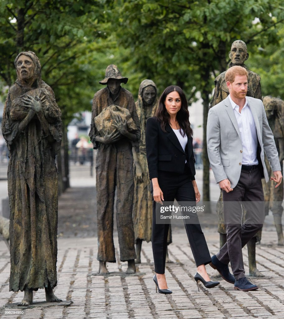 Prince Harry, Duke of Sussex and Meghan, Duchess of Sussex visit the Famine Memorial during their visit to Ireland on July 11, 2018 in Dublin, Ireland.