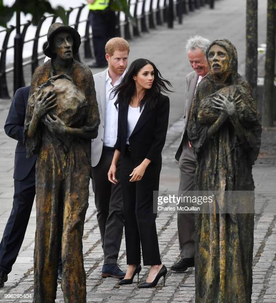 Prince Harry Duke of Sussex and Meghan Duchess of Sussex visit the Famine Memorial at Custom House Quay on the second day of their official two day...