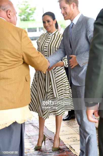 Prince Harry Duke of Sussex and Meghan Duchess of Sussex visit the St George Building to call on the Prime Minister S Akilisi Pohiva on October 26...