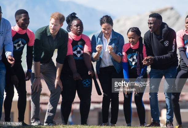 Prince Harry Duke of Sussex and Meghan Duchess of Sussex visit Waves for Change an NGO at Monwabisi Beach during their royal tour of South Africa on...
