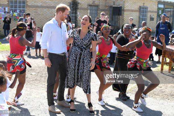Prince Harry Duke of Sussex and Meghan Duchess of Sussex visits the Nyanga Township during their royal tour of South Africa on September 23 2019 in...