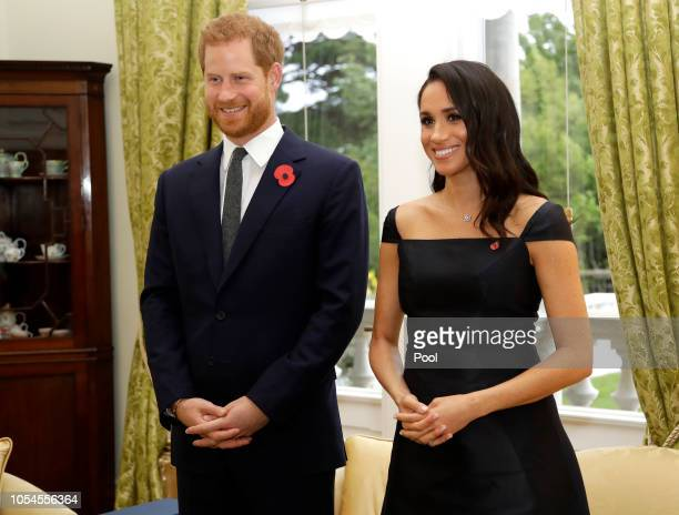Prince Harry Duke of Sussex and Meghan Duchess of Sussex wait to meet New Zealand Prime Minister Jacinda Ardern at Government House on October 28...