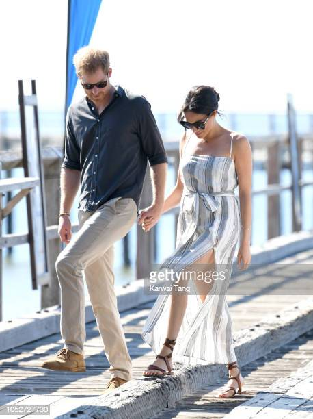 Prince Harry, Duke of Sussex and Meghan, Duchess of Sussex walk along the picturesque Kingfisher Bay Jetty on October 22, 2018 in Fraser Island,...
