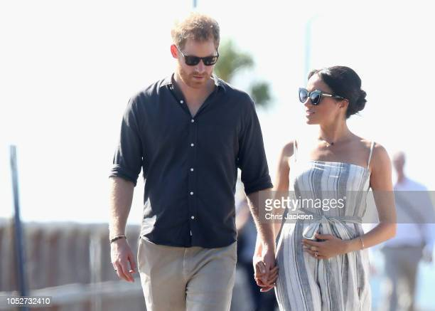 Prince Harry Duke of Sussex and Meghan Duchess of Sussex walk along the picturesque Kingfisher Bay Jetty on October 22 2018 in Fraser Island...