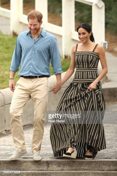 Prince Harry, Duke of Sussex and Meghan, Duchess of Sussex walk down to Bondi Beach on October 19, 2018 in Sydney, Australia. The Duke and Duchess of...