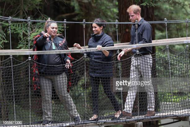 Prince Harry Duke of Sussex and Meghan Duchess of Sussex walk in the treetops as they visit Redwoods Tree Walk on October 31 2018 in Rotorua New...