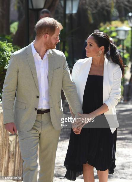 Prince Harry Duke of Sussex and Meghan Duchess of Sussex walk through the walled public Andalusian Gardens which has exotic plants flowers and fruit...
