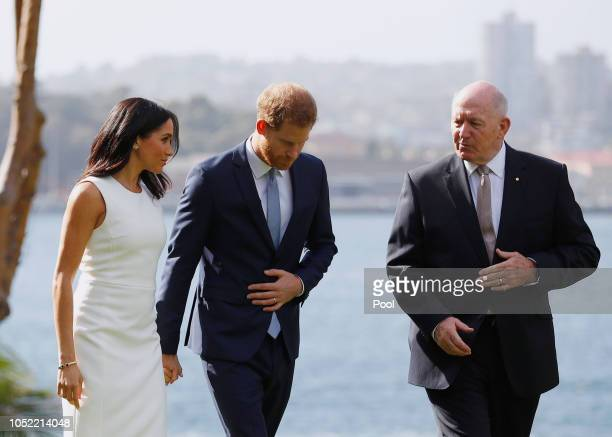 Prince Harry Duke of Sussex and Meghan Duchess of Sussex walk with Australia's Governor General Peter Cosgrove at Admiralty House on October 16 2018...