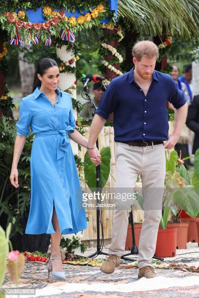 Prince Harry Duke of Sussex and Meghan Duchess of Sussex walking over to participate in the Unveiling of The Queen's Commonwealth Canopy at Tupou...