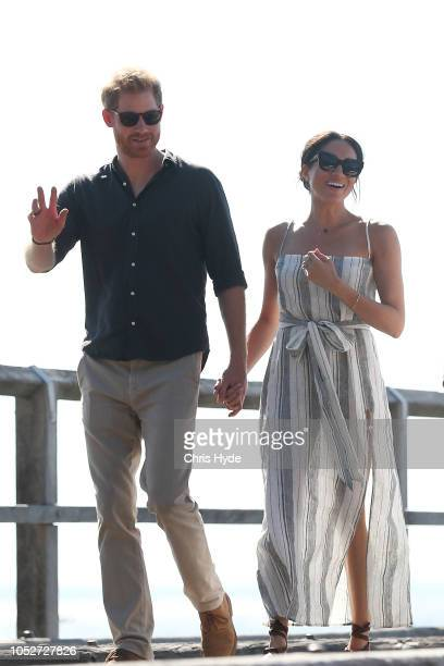 Prince Harry, Duke of Sussex and Meghan, Duchess of Sussex walking along Kingfisher bay walk about on October 22, 2018 in Fraser Island, Australia....