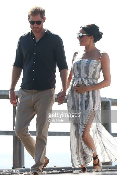 Prince Harry Duke of Sussex and Meghan Duchess of Sussex walking along Kingfisher bay walk about on October 22 2018 in Fraser Island Australia The...