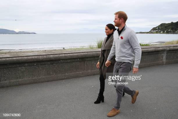 Prince Harry Duke of Sussex and Meghan Duchess of Sussex walking along Lyall Bay to visit Maranui Cafe on October 29 2018 in Wellington New Zealand...