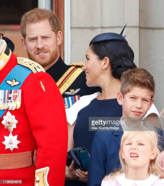 Prince Harry, Duke of Sussex and Meghan, Duchess of Sussex watch a flypast from the balcony of Buckingham Palace during Trooping The Colour, the...