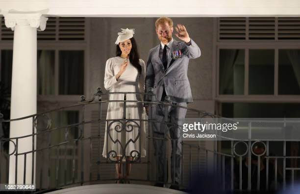 Prince Harry Duke of Sussex and Meghan Duchess of Sussex wave from the balcony of the Grand Pacific Hotel in Suva October 23 2018 in Suva Fiji The...