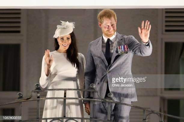 Prince Harry, Duke of Sussex and Meghan, Duchess of Sussex wave from the balcony of the Grand Pacific Hotel in Suva October 23, 2018 in Suva, Fiji....