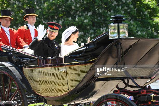 Prince Harry Duke of Sussex and Meghan Duchess of Sussex wave from the Ascot Landau carriage during the procession after getting married at St...