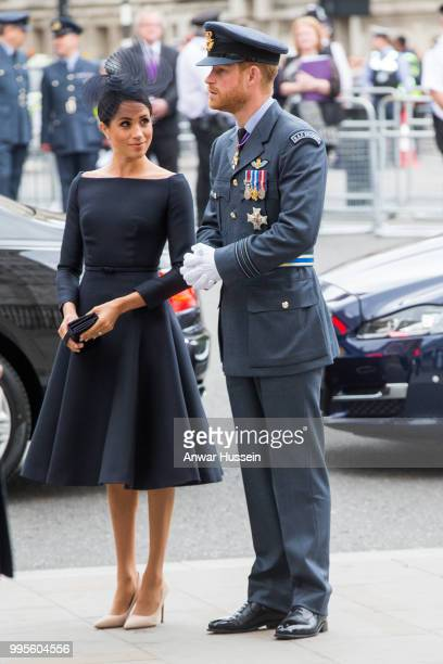 Prince Harry, Duke of Sussex and Meghan, Duchess of Sussex, wearing a dark navy Dior dress and a hat by milliner Stephen Jones, attend a service at...
