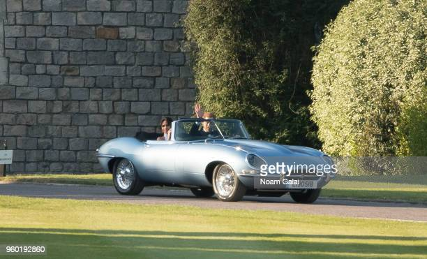 Prince Harry Duke of Sussex and Meghan Markle Duchess of Sussex leave Windsor Castle in Windsor on May 19 2018 in an EType Jaguar after their wedding...