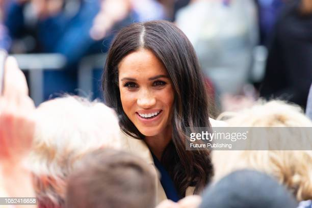 Prince Harry Duke of Sussex and Meghan Markle Duchess of Sussex meet fans at Government House in Melbourne Australia