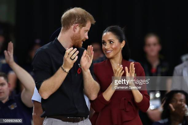 Prince Harry Duke of Sussex and Meghan the Duchess of Sussex participate in the medal ceremony following the gold medal match of the Wheelchair...