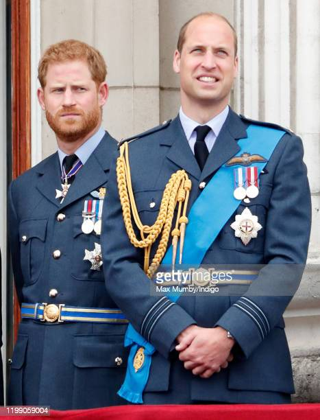 Prince Harry, Duke of Sussex and Prince William, Duke of Cambridge watch a flypast to mark the centenary of the Royal Air Force from the balcony of...