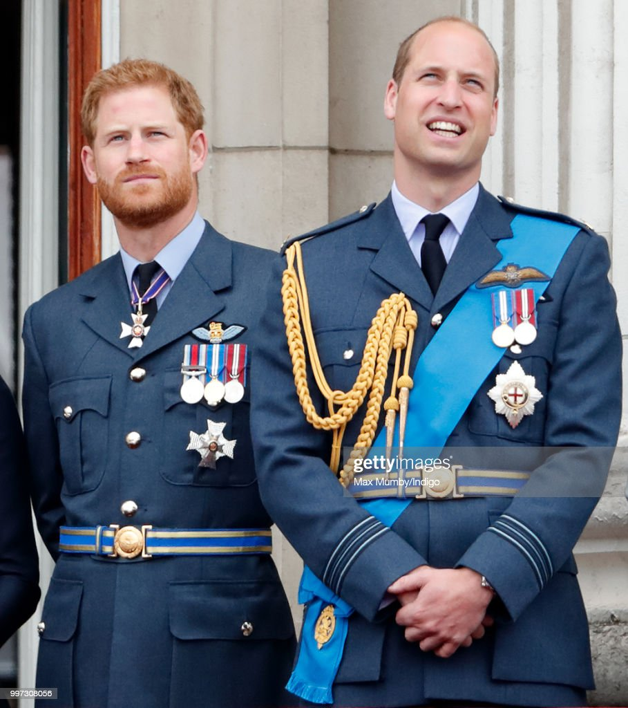 Prince Harry, Duke of Sussex and Prince William, Duke of Cambridge watch a flypast to mark the centenary of the Royal Air Force from the balcony of Buckingham Palace on July 10, 2018 in London, England. The 100th birthday of the RAF, which was founded on on 1 April 1918, was marked with a centenary parade with the presentation of a new Queen's Colour and flypast of 100 aircraft over Buckingham Palace.