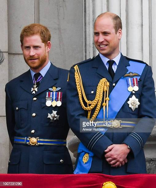 Prince Harry Duke of Sussex and Prince William Duke of Cambridge stand on the balcony of Buckingham Palace to view a flypast to mark the centenary of...