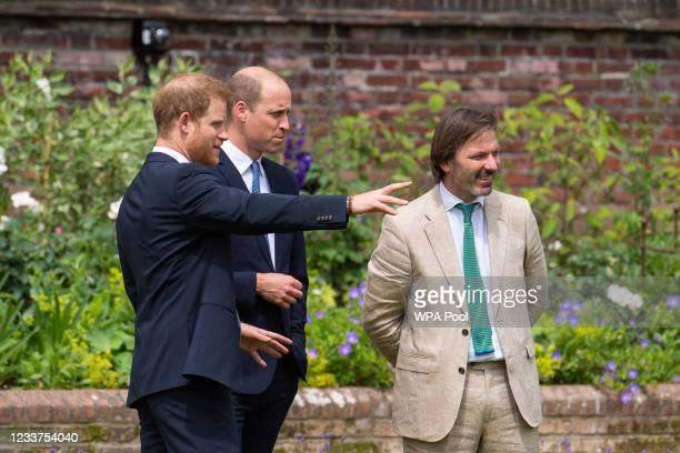 Prince Harry, Duke of Sussex and Prince William, Duke of Cambridge speak with garden designer Pip Morrison, during the unveiling of a statue they...