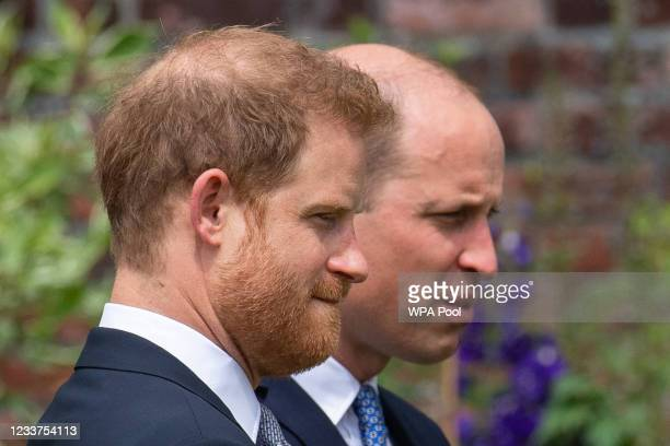 Prince Harry, Duke of Sussex and Prince William, Duke of Cambridge during the unveiling of a statue they commissioned of their mother Diana, Princess...
