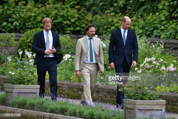 Prince Harry, Duke of Sussex and Prince William, Duke of Cambridge with garden designer Pip Morrison, arrive for the unveiling of a statue they...