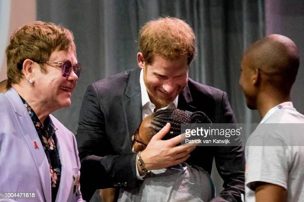 Prince Harry Duke of Sussex and Sir Elton John during the International Aids Conference on July 24 2018 in Amsterdam Netherlands