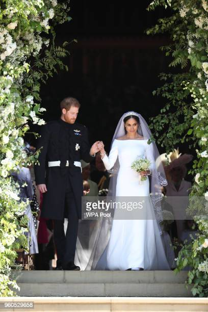 Prince Harry, Duke of Sussex and the Duchess of Sussex depart after their wedding ceremony at St George's Chapel at Windsor Castle on May 19, 2018 in...