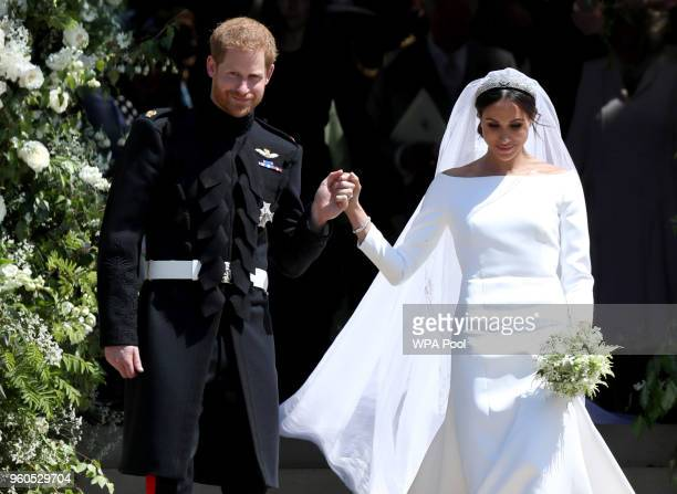 Prince Harry Duke of Sussex and the Duchess of Sussex depart after their wedding ceremony at St George's Chapel at Windsor Castle on May 19 2018 in...