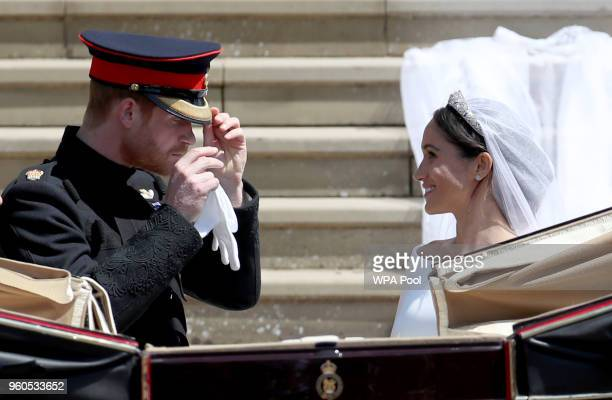 Prince Harry Duke of Sussex and the Duchess of Sussex depart after their wedding ceremonyat St George's Chapel at Windsor Castle on May 19 2018 in...